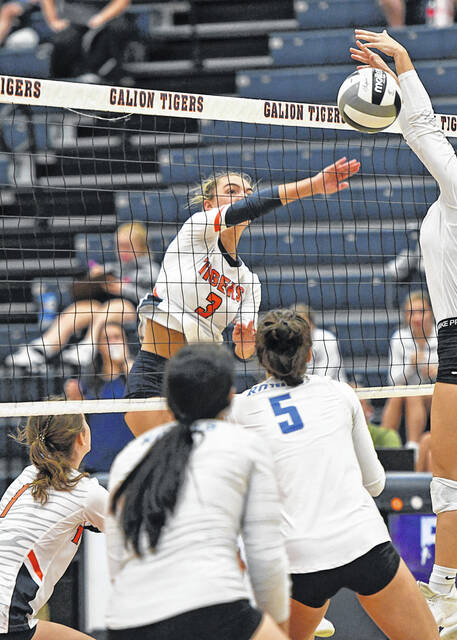 Galion's Ashley Dyer (3) spikes the ball past a Wynford blocker during the Tigers 3-1 win against the Royals on Monday, Oct. 11, 2021.