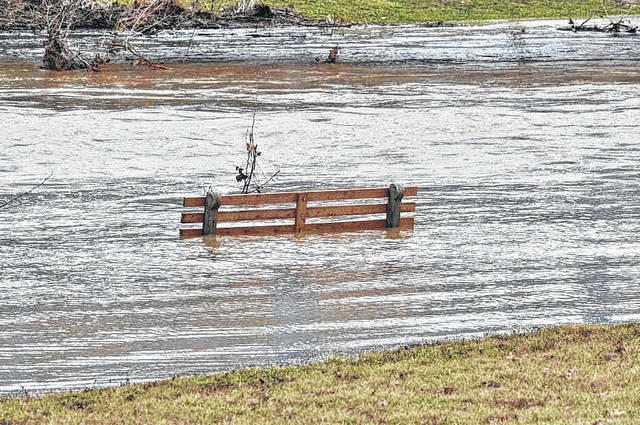 High waters along the Clear Fork River made some areas designed for comfortable gazing a bit treacherous. Benches along the river were in deep water, with the non stop rains the area has been experiencing. Photo courtesy Jeff Hoffer