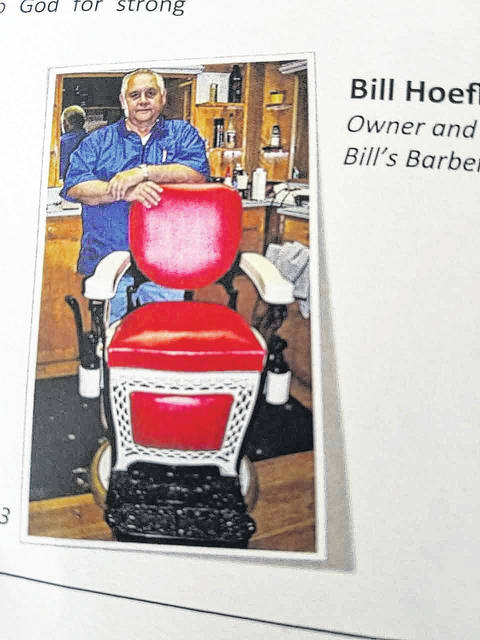 Bill Hoeflich, with his barber chair. Submitted photo