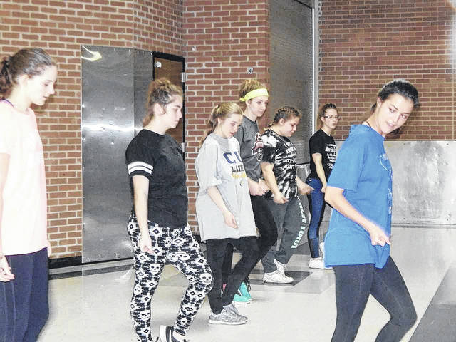 Choreographer Maria Marzarotto works with students who are getting ready for a production of Footloose. Submitted photo