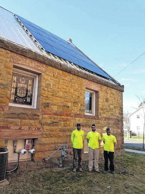 A completed solar panel at All Souls Unitarian Universalist Church is the work of this crew from Third Sun Solar, from Athens. The workers who put up the solar panels are from left, David Jolley, Eric Cain, and Ben Bailey. It took two days to install the panels on the roof. Inside work was done last week to prepare other elements of the project. Louise Swartzwalder | Bellville Star