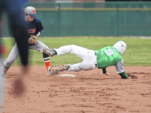 Photo by Jeff Hoffer Clear Fork's Ethan Sparks slides awkwardly into second base while Galion's Spencer Keller looks to apply the tag during Wednesday's game in Bellville. The Colts defeated the Tigers 10-0.