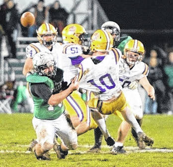By Jeff Hoffer Bryan QB Nate Miller is hit by a Clear Fork defender Saturday night.