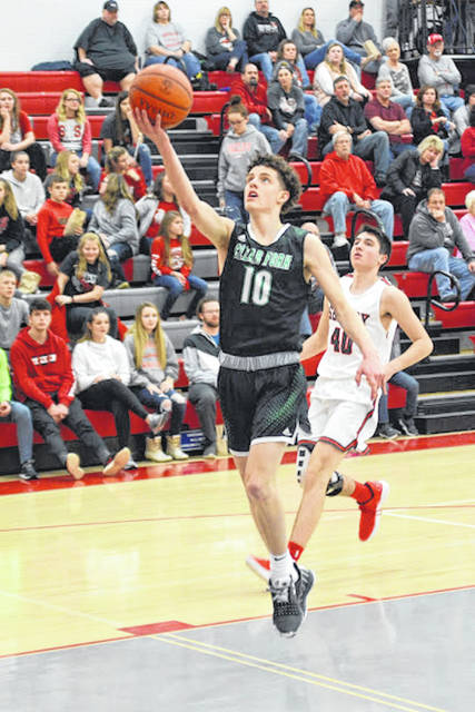 Gannon Seifert drives the lane against Shelby.
