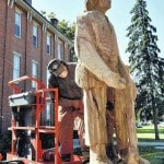 Wood carver tackles town square stump