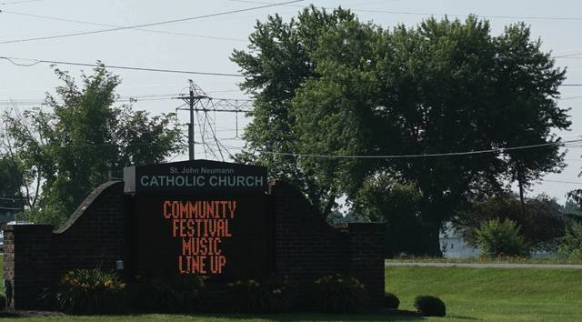 St. John's sign gives the musical lineup for this weekend's Community Festival.