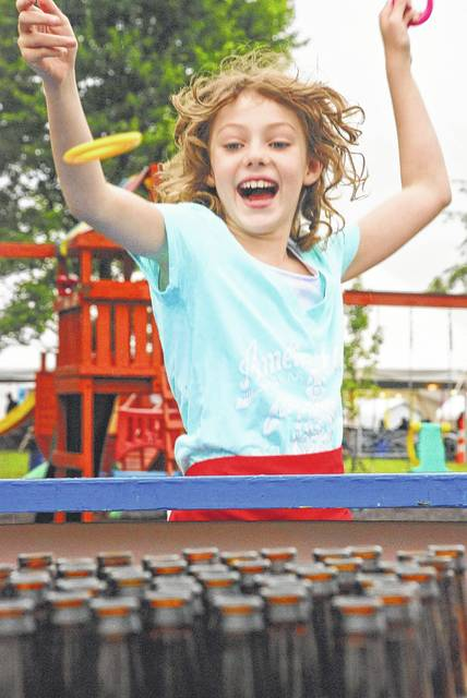 The non-stop rain Friday evening didn't discourage parishioners of St. John Neumann Catholic Church in Sunbury from holding their annual community festival. Julianna Maynard, 8, found great joy in getting out and trying her hand at the ring toss game once the rain tapered off to a few sprinkles. The weather was much better on Saturday for the second day of the annual festival.