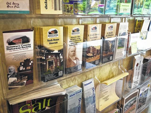 There are many brochures and pamphlets lining the wall of the entrance to the Delaware County Convention & Visitor's Bureau.