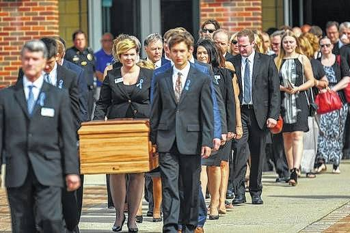 The casket of Otto Warmbier is carried from Wyoming High School after his funeral Thursday in Wyoming, Ohio. Warmbier, a 22-year-old University of Virginia undergraduate student who was sentenced in March 2016 to 15 years in prison with hard labor in North Korea, died this week, days after returning to the United States.