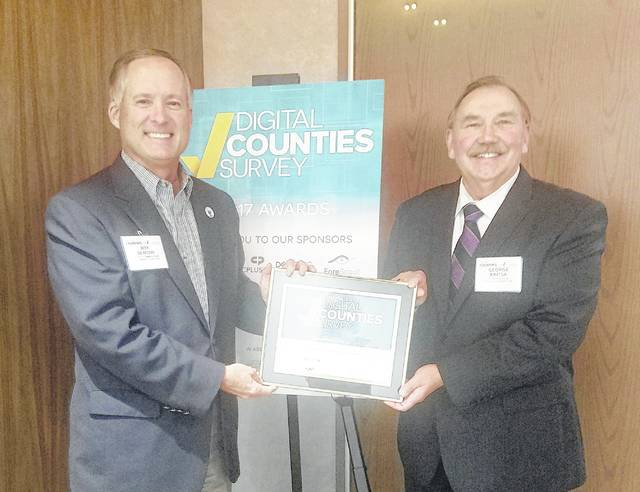 Delaware County Commissioner Jeff Benton, left, and Delaware County Auditor George Kaitsa display an award from The Center for Digital Government. Delaware County was the No. 2 county government in the 150,000 to 249,999 population category in the annual Digital Counties Survey competition. Delaware County placed ninth last year.