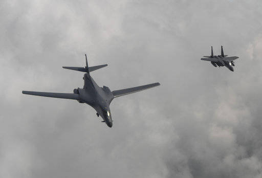 In this photo provided by South Korea Defense Ministry, a U.S. Air Force B-1B bomber, left, flies with a South Korean fighter jet F-15K on Sunday over the Korean Peninsula, South Korea. The United States flew two supersonic bombers over the Korean Peninsula on Sunday in a show of force against North Korea following the country's latest intercontinental ballistic missile test.