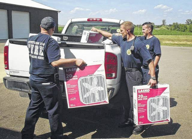 As temperatures climb into the 90-degree range in Delaware County, the need for box fans increases. The Delaware County Emergency Management Agency and People In Need Inc. have teamed up with area fire departments to collect box fans for people who cannot afford them. Firefighters from the Berkshire, Sunbury, Trenton, Galena Fire District load donated fans into the PIN pickup truck.