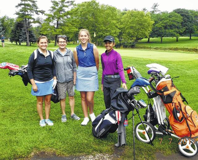 The girls 14-17 age group of the recent Little Brown Jug Junior Golf Classic with walking scorer Mary Hilborn pose for a shot.