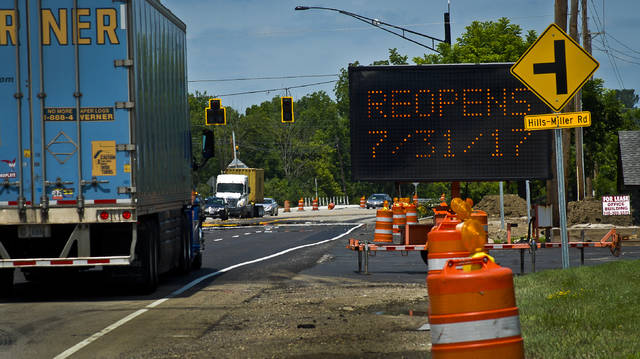 The signs at the junction of U.S. 23 and Hills-Miller Road say that the road will re-open Monday, July 31. The estimated completion date had been July 20, but weather delayed the work, according to Speedway, which is upgrading the intersection as part of its new store project on U.S. 23 North.