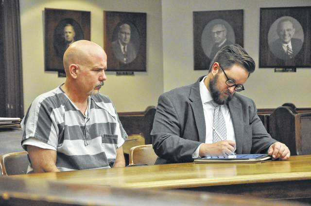 Dickerson (left) with his attorney Brian Jones during the arraignment Thursday morning in Delaware County Common Pleas Court.