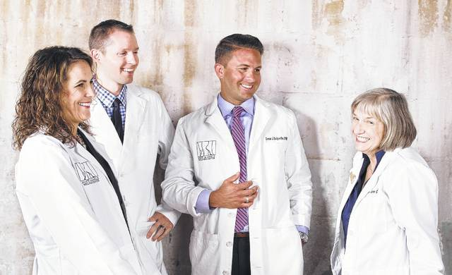 From left, Dr. Martha Anderson, Dr. Christopher Tulodzieski, Dr. Drew Belpedio and Dr. Jane Graebner form the team of doctors and surgeons at the Foot & Ankle Wellness Center in Delaware.