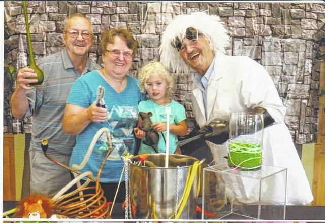 Grandparents Day mad scientist, SourcePoint member and volunteer Jack McGraw cooks up fun in the lab with members Jet and Lori Talbert and their grandchild, two-year-old Mackenzie Rathjens at last year's event. Grandparents Day will take place Saturday, Aug. 19 from 8:30 a.m. to noon at SourcePoint, 800 Cheshire Road in Delaware. The event is free and open to the public. Courtesy photo