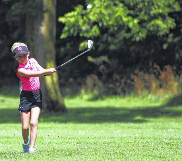 Brooke Setmire, an elementary school student in the Big Walnut Local School District, hits an approach shot during Saturday's Little Brown Jug Junior Golf Classic at Hidden Valley Golf Course.