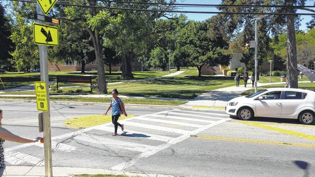 Enhanced crosswalk warning devices are up and operating at the Liberty Street-Rowland Avenue intersection in the city of Delaware. The rectangular rapid flash beacons are user-actuated LEDs that supplement warning signs at unsignalized intersections, reducing crashes between vehicles and pedestrians. The RRFBs will be installed at crosswalks on Troy Road and Pennsylvania Avenue.