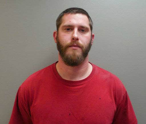 Authorities say a manhunt is under way for Branden Powell, a rape suspect who overpowered a Paulding County sheriff's deputy in a transport van and stole his gun and ammunition.
