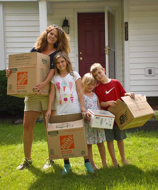The stress of fighting to keep her mother's house never diminished Marci Maynard's faith that it would all work out. With faces full of smiles Friday, the Maynard family, (L-R) Marci, Kate, Hailey and Collin moved into their new home.