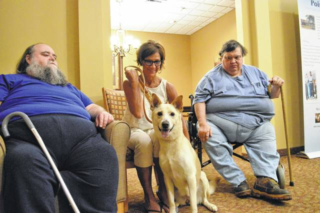 Larry McKenzie, left, Joyce Merrick, and Steve McKenzie pose with their dog Sally. The McKenzie brothers owned the dog for all her life until Jan. 8. The two were admitted at OhioHealth Grady Memorial Hospital in Delaware where they met Merrick, a nurse at the facility. The three agreed for Merrick to foster and adopt the dog.