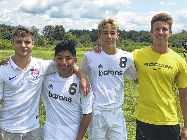 Sam Scharff, Felipe Scharff, Jack Rotondo and Mitch Rotondo, from left to right, pose for a picture before Saturday's BV Alumni Soccer Match.