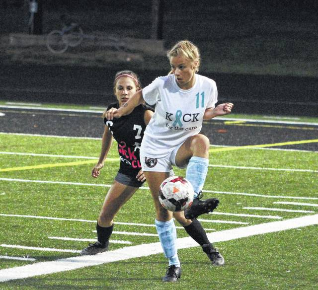 Hayes' Grace Miller (11) and Buckeye Valley's Kennedy Wirth battle for possession during the first half of Thursday's non-league showdown in Delaware.