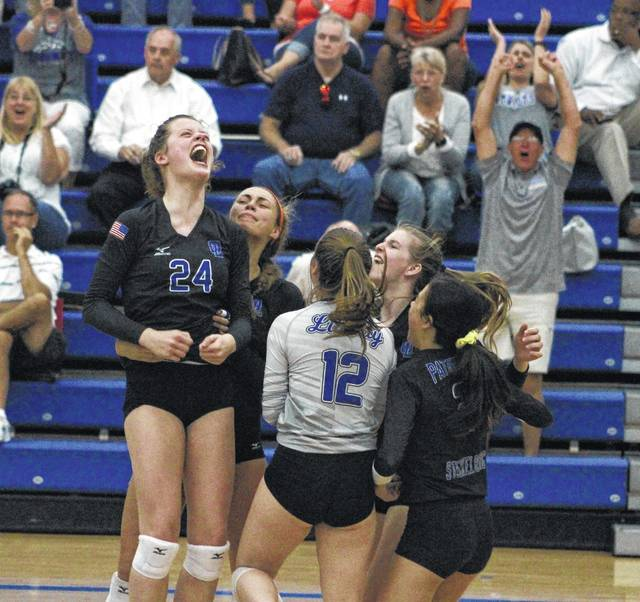 Olentangy Liberty players celebrate after outlasting rival Olentangy Orange in five sets Tuesday in Powell. With the win, the Patriots are tied with the Pioneers atop the league standings.