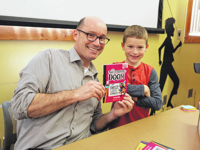 Children's author Troy Cummings shares a moment with a young library patron during Cummings' program in May 2016. Cummings is one of several authors the Friends of the Delaware County District Library has hosted throughout its 10 years of service to the library.