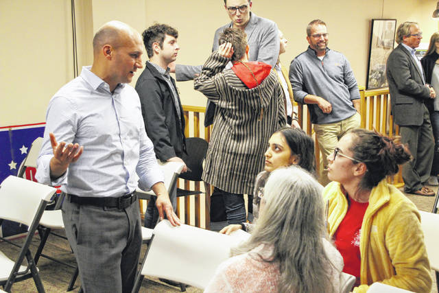State Sen. Joe Schiavoni, left, talks with Ohio Wesleyan University students and Peg Watkins from the Delaware County Board of Elections following the Delaware County Young Democrats forum on Tuesday. Schiavoni, who is one of five Democrats running for Ohio governor in 2018, was the guest speaker for the event.