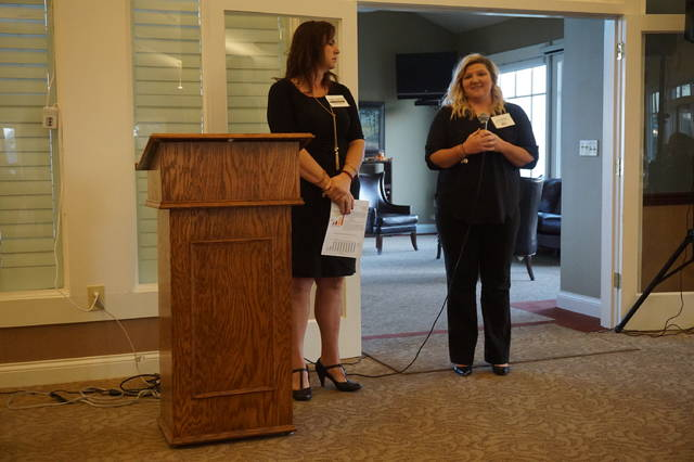 Big Walnut Superintendent Angie Pollock, left, and bond/levy issue campaign chair Tara Shelby speak at a Sunbury/Big Walnut Area Chamber of Commerce event last Friday.