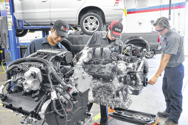 Students in the Delaware Area Career Center Automotive Technology lab look over the three donated engines from Volkswagen Friday afternoon at the North Campus. From left to right are Keshav Acharya, a senior at Westerville South, Cole Conkey, a senior at Westerville Central, and Kyle Reiniger, a senior at Westerville North.