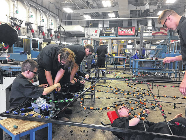DACC welding students work on their Christmas display for Butch Bando's Fantasy of Lights last week at the DACC's North Campus. The guidelines for the display were that it had to be Christmas and welding related and would include the DACC logo as well as the students' graduation year.