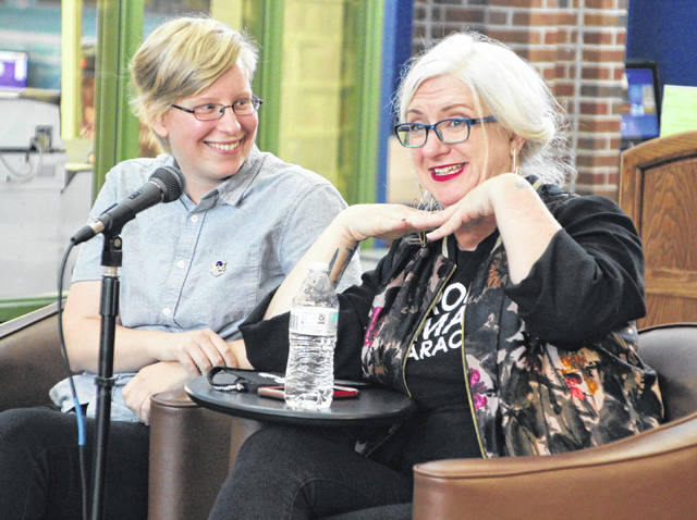"""Grace Ellis, left, and Lauren McCubbin, two-thirds of the creative team behind the """"Moonstruck"""" comic book series, share a laugh with the audience during their panel discussion on Saturday at the Delaware County District Library's Great GeekFest. The book is distributed through Image Comics."""
