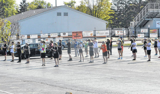 The Delaware Hayes High School Marching Band practices in the student parking lot at Hayes on Tuesday afternoon. The band recently participated in Ohio Music Education Association competitions in Louisville and Loveland, earning third place in Class AA at both events.