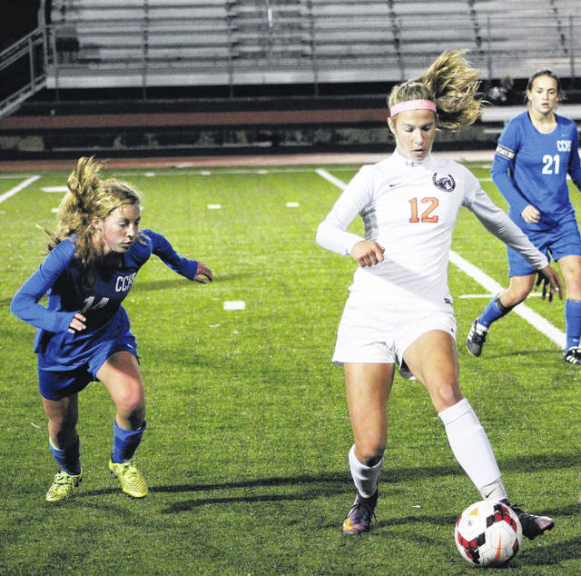 Hayes' Sydney McMillin (12) dribbles around Central Crossing's Lilly Dimmerling during the first half of Monday's Division I district tournament opener in Delaware.