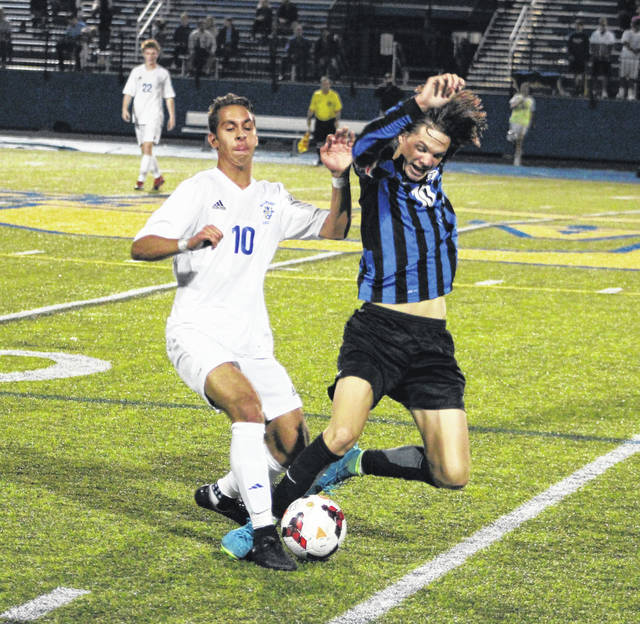Olentangy's Eli Stoner, left, and Liberty's Colin McCort battle for possession during the first half of Tuesday's OCC showdown in Lewis Center.