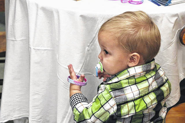 Owen Miller toddles around during a recent ceremony when his parents, Melissa and Mike Miller, donated a cuddle cot to OhioHealth Grady Memorial Hospital. Cuddle cots cool the bodies of deceased infants, allowing families to spend time with them. Owen's twin, Henry, passed away in March 2016.