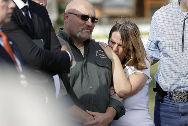 Pastor Frank Pomeroy and his wife Sherri join a news conference Monday near the First Baptist Church of Sutherland Springs in Sutherland Springs, Texas. A man opened fire inside the church in the small South Texas community on Sunday, killing and wounding many. The Pomeroys daugher, Annabelle, 14, was killed in the shooting.