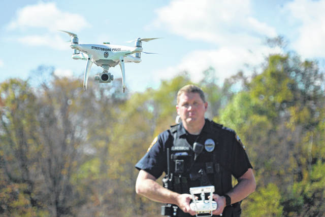 Streetsboro Police Officer Scott Hermon pilots the department's first drone in Streetsboro, Ohio. Streetsboro Police became one of hundreds of agencies across the country adopting drone technology when Hermon became the first Streetsboro officer certified to fly drones in October. Streetsboro Police say they can't afford a helicopter, but a drone provides many of the same capabilities at a fraction of the price.