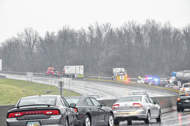 A tow truck hauls a jackknifed semi truck back onto U.S. 23 North in Delaware shortly before police reopened one lane of traffic Thursday. No injuries were reported in the crash.