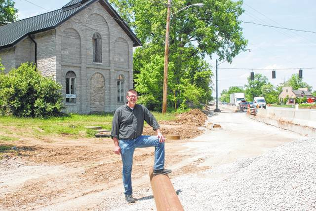 Two years ago, Dave Kerr stands in front of the old stone Methodist-Episcopal church at the corner U.S. 23 and State Route 315 two years ago when the Ohio Department of Transportation was re-aligning the intersection.