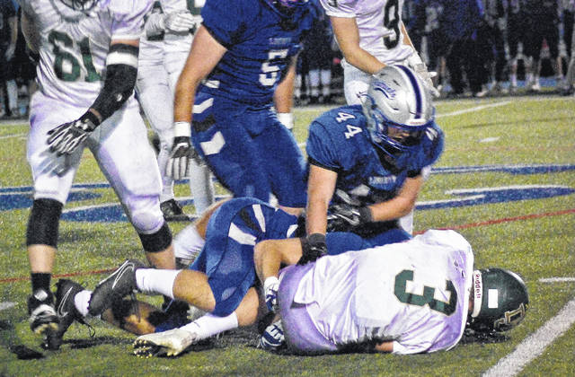 A swarm of Liberty players sack Jerome's Hayden Schell in the first quarter of Friday's Division I playoff game in Powell.