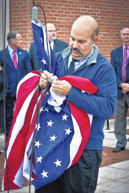 After delays in construction, the new $39 million, 94,450 square-foot Delaware County Courthouse officially opened for business in flag raising ceremony Monday, Nov. 6. Facilities Director Jon Melvin, who was instrumental in overseeing the construction of the building, was given the honor of raising the United States flag.