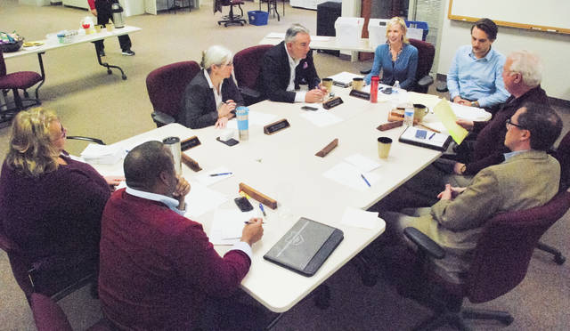 The Delaware County Board Elections sat and meticulously went through provisional ballots Friday afternoon. The board was asked by the Franklin County Board of Elections to move its ruling on provisional ballots from Nov. 27 to this past Friday to accommodate the City of Westerville's charter policy that requires swearing in candidates on Dec.1.