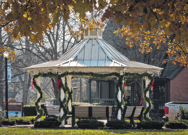 Taking advantage of the warmer weather, Sunbury maintenance crews finished putting up the village holiday decorations on Monday. On the corner of the village square, the gazebo stands ready for this weekend's Christmas on the Square scheduled from 4 to 8 p.m. on Saturday, Dec. 2.