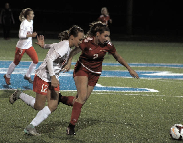 Big Walnut's Avery Schone (12) battles for possession with Indians Hill's Bryn Wirthlin during the first half of Tuesday's Division II state semifinal.
