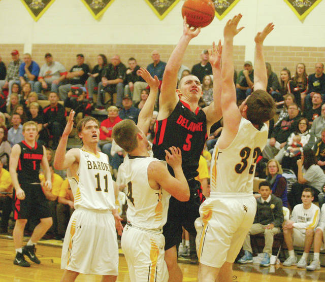 Hayes' Terin Kinsway (5) puts up a shot in traffic during a game against Buckeye Valley last season.