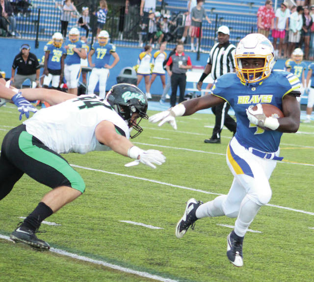 Olentangy's Jaden Konadu bounces to the outside during the first half of a Week 4 showdown against visiting Dublin Coffman. The two meet up again Friday, this time in Dublin for the first round of the Division I playoffs.